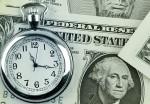 Stopwatch and dollar bills.